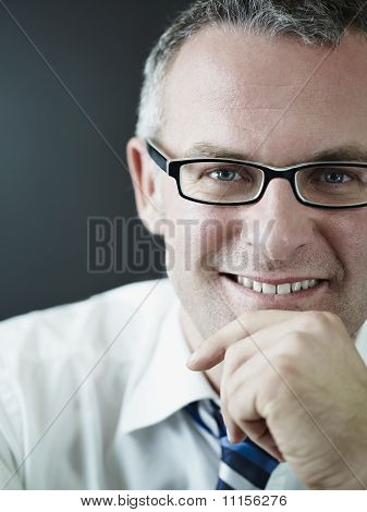 Confident Businessman Smiling At Camera