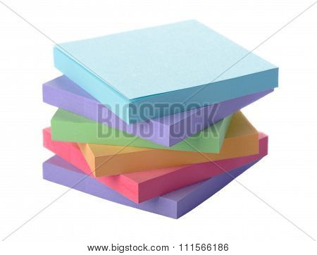 Stack of colored paper stickers on a white background