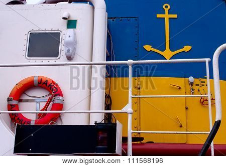 Deck Of A Boat With A Lifebuoy And Aa Anchor Sign