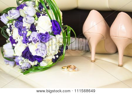 Wedding bouquet with blue flowers and bride shoes