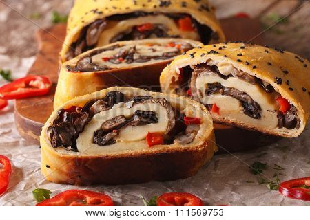 Strudel Stuffed With Wild Mushrooms Close-up On A Board. Horizontal