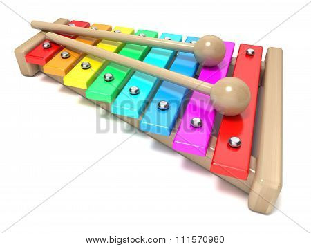 Xylophone with rainbow colored keys and with two wood drum sticks