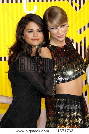 LOS ANGELES, CA - AUGUST 30, 2015: Taylor Swift and Selena Gomez at the 2015 MTV Video Music Awards held at the Microsoft Theater in Los Angeles, USA on August 30, 2015.