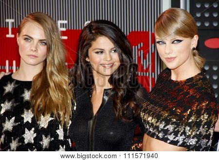 LOS ANGELES, CA - AUGUST 30, 2015: Cara Delevingne, Taylor Swift and Selena Gomez at the 2015 MTV Video Music Awards held at the Microsoft Theater in Los Angeles, USA on August 30, 2015.
