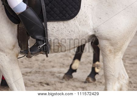 view of a boot rider with spurs at jumping competition