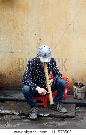Vietnamese Man Smoking On The Street