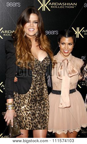 HOLLYWOOD, CA - AUGUST 17, 2011: Khloe Kardashian and Kourtney Kardashian at the Kardashian Kollection Launch Party held at the Colony in Hollywood, USA on August 17, 2011.