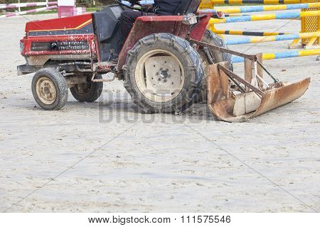 Smoothing Tractor Working At Horse Jumping Competition