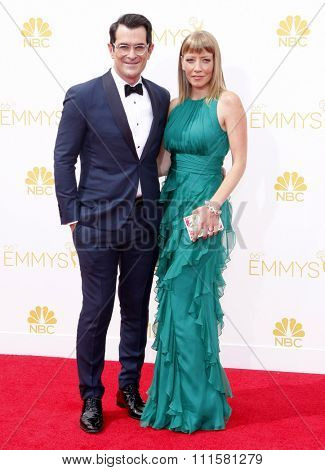LOS ANGELES, CA - AUGUST 25, 2014: Ty Burrell and Holly Anne Brown at the 66th Annual Primetime Emmy Awards held at the Nokia Theatre L.A. Live in Los Angeles, USA on August 25, 2014.