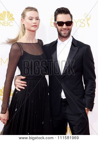 LOS ANGELES, CA - AUGUST 25, 2014: Behati Prinsloo and Adam Levine at the 66th Annual Primetime Emmy Awards held at the Nokia Theatre L.A. Live in Los Angeles, USA on August 25, 2014.