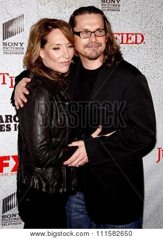 HOLLYWOOD, CA - MARCH 08, 2010: Kurt Sutter and Katey Sagal at the premiere screening of FX's 'Justified' held at the DGA Theater in Hollywood, USA on March 8, 2010.