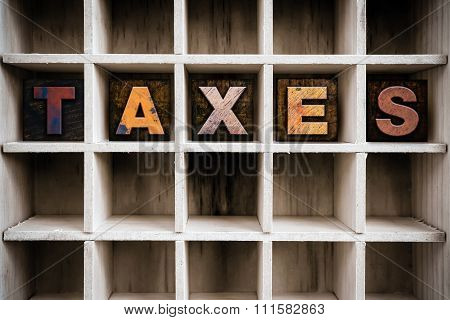 Taxes Concept Wooden Letterpress Type In Drawer