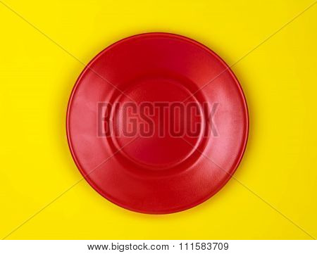 Top View Of Empty Red Dish Vibrant Color Background