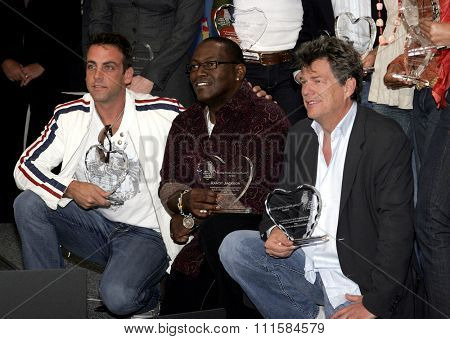LOS ANGELES, CA - NOVEMBER 15, 2005: Carlos Ponce, Randy Jackson and David Foster at the 2005 World Children's Day at the Ronald McDonald House in Los Angeles, USA on November 15, 2005.