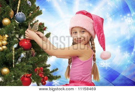 Little santa girl decorating the christmas tree