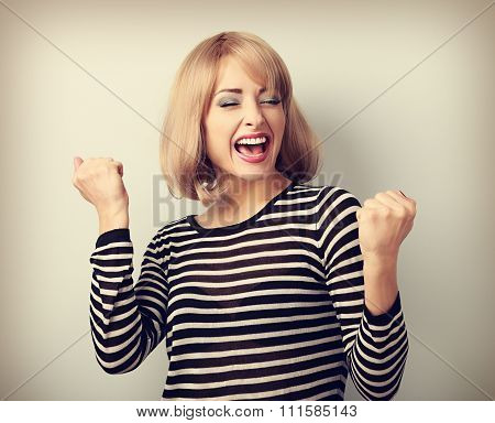 Happy Excited Winner With Opened Mouth. Happy Blond Young Satisfacted Woman Showing The Gesture By F