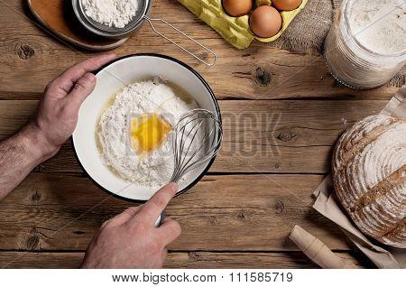 Male Baker Prepares Bread