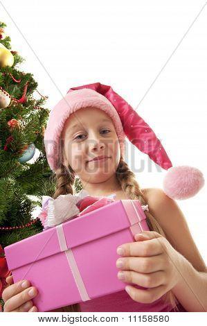 Little santa girl holding a gift box