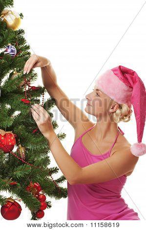 Santa beautiful girl decorating the christmas tree