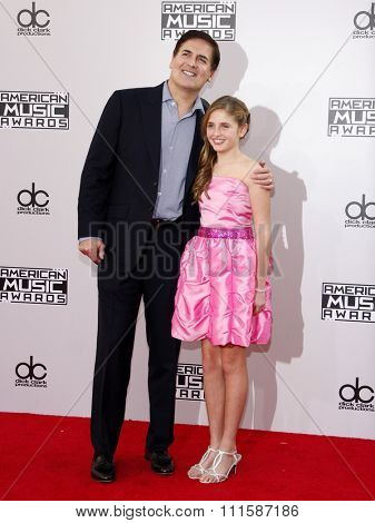 LOS ANGELES, CA - NOVEMBER 23, 2014: Mark Cuban and Alexis Cuban at the 2014 American Music Awards held at the Nokia Theatre L.A. Live in Los Angeles on November 23, 2014.
