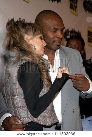10/17/2005. Fergie of Black Eyed Peas and Mike Tyson at the Usher Host Truth Tour DVD Launch Party at the Hollywood Roosevelt Hotel in Hollywood, CA, USA.