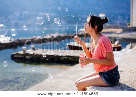 Girl Blow Bubbles On Beach