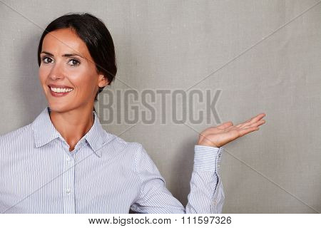 Businesswoman While Holding Left Palm Up