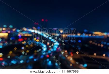 Modern city traffic road at night. Transport junction. Bokeh