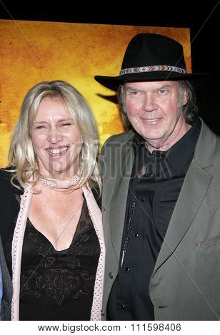 HOLLYWOOD, CALIFORNIA. February 7, 2006. Neil Young and Pegi Young attend the Los Angeles Premiere of