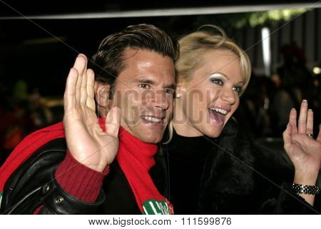Barbara Moore and Lorenzo Lamas at the 73rd Annual Hollywood Christmas Parade held at the Hollywood Roosevelt Hotel in Hollywood, USA on November 28, 2004.