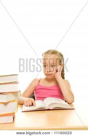 Small beautiful thinking schoolgirl