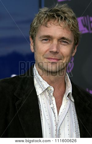 John Schneider at The WB Network's 2004 All Star Party- Red Carpet & Party at The Lounge At Astra West in Los Angeles, USA on July 14, 2004.