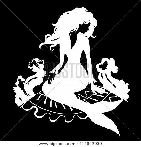 Silhouette mermaid sitting on the stone