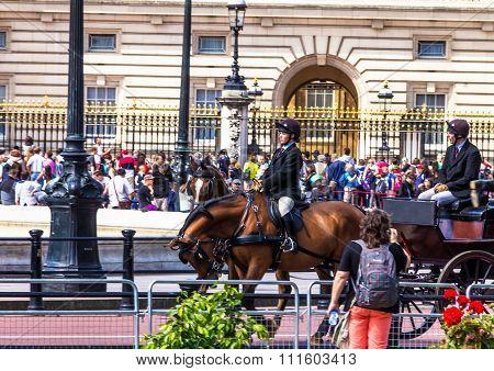 Tourists Gather At The Gates Of Buckingham Palace