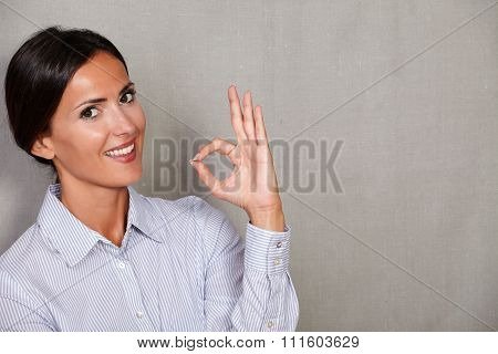 Satisfied Lady Smiling And Showing Ok Sign