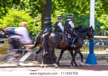 Police Women On Horseback On  The Mall, Street In Front Of Buckingham Palace In London