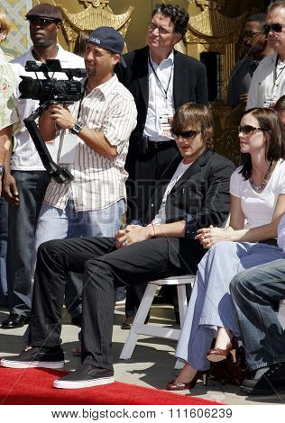 09/06/2006 - Hollywood - Ashton Kutcher at the Kevin Costner Hand and Footprints Ceremony held at the Grauman's Chinese Theater in Hollywood, California, United States.