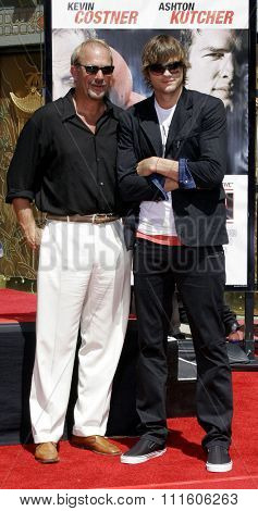 09/06/2006 - Hollywood - Kevin Costner and Ashton Kutcher at the Kevin Costner Hand and Footprints Ceremony held at the Grauman's Chinese Theater in Hollywood, California, United States.