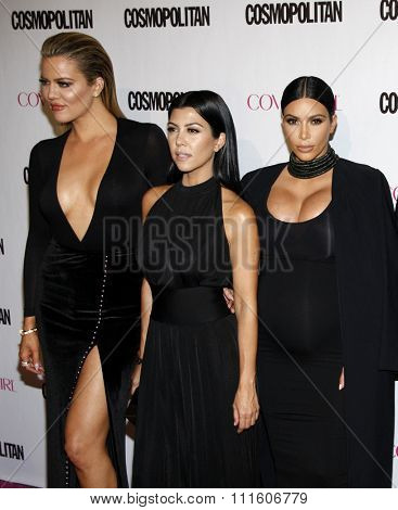 Khloe Kardashian, Kourtney Kardashian and Kim Kardashian at the Cosmopolitan's 50th Birthday Celebration held at the Ysabel in West Hollywood, USA on October 12, 2015.