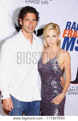Camille Grammer and Dimitri Charalambopoulos at the 19th Annual Race To Erase MS held at the Hyatt Regency Century Plaza in Los Angeles, California, United States on May 18, 2012.