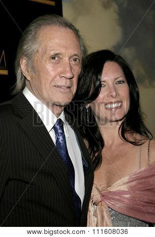 BEVERLY HILLS. CALIFORNIA. April 28, 2005. David Carradine and Annie Bierrman attend The 9th Annual PRISM Awards The Beverly Hills Hotel in Beverly Hills, California, United States.