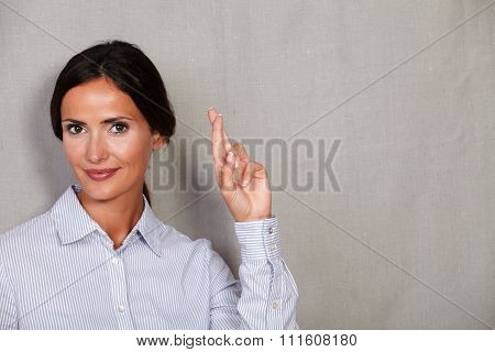 Long Hair Businesswoman Crossing Her Fingers