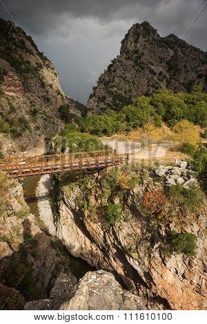 Scenic Mountain Autumn Landscape With River And Bridge