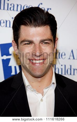 Max Greenfield at the Alliance for Children's Rights Dinner Honoring Kevin Reilly held at the Beverly Hilton Hotel in Beverly Hills, USA on March 1, 2012.