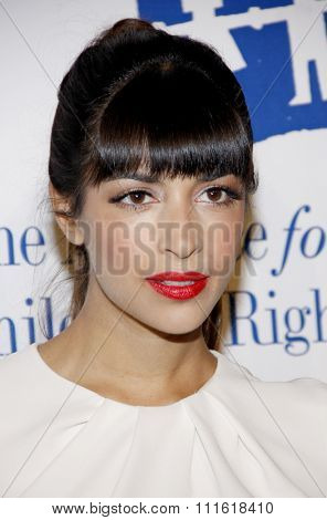 Hannah Simone at the Alliance for Children's Rights Dinner Honoring Kevin Reilly held at the Beverly Hilton Hotel in Beverly Hills, USA on March 1, 2012.