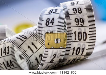 Curved measuring tape. Measuring tape of the tailor. Closeup view of measuring tape