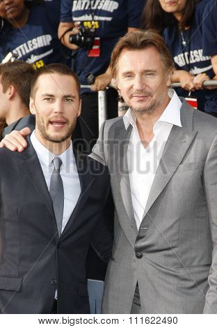 Taylor Kitsch and Liam Neeson at the Los Angeles premiere of 'Battleship' held at the Nokia Theatre L.A. Live in Los Angeles, USA on May 10, 2012.