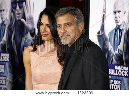 HOLLYWOOD, CA, USA - OCTOBER 26, 2015: Amal Clooney and George Clooney at the Los Angeles premiere of 'Our Brand Is Crisis' held at the TCL Chinese Theatre in Hollywood.