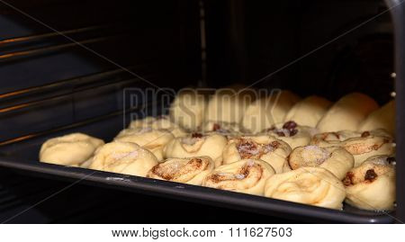 Baking Sheet With Pies And Buns In An Oven, The Beginning Of Baking