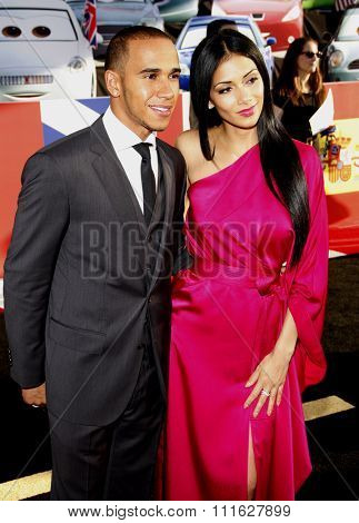 Lewis Hamilton and Nicole Scherzinger at the Los Angeles premiere of 'Cars 2' held at the El Capitan Theatre in Hollywood, USA on June 18, 2011.
